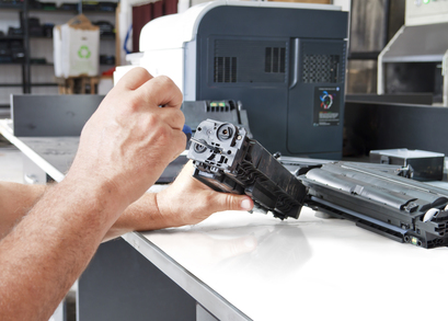 Hands repairing laser toner cartridge