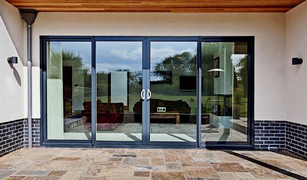 Плюсы раздвижных алюминиевых дверей